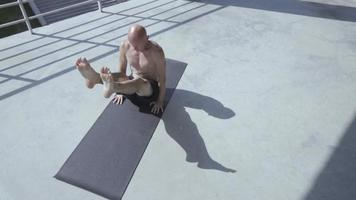 Young Man with Tattoos Does Yoga Exercises video