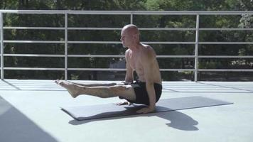 Young Guy with Tattoos Does Yoga Exercises video