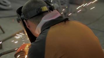 Workers in A Welding Mask in A Steel Workshop video