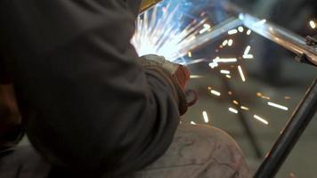 Worker in A Welding Mask in A Steel Workshop video
