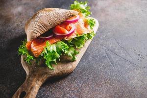 Healthy sandwich with rye bread bun photo