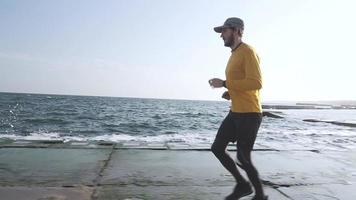 Young Male Runner Training Along the Sea video