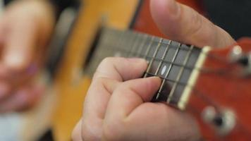 Playing the Strings of A Ukulele video