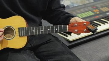 A Person in The Studio Tuning Their Ukulele video