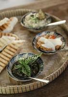 Vegetarian Turkish mezze snack tapas platter on rustic wood restaurant table photo