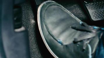 Accelerator and break pedal in a car video