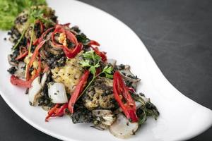 Stir fry fresh spicy squid with Kampot pepper famous Khmer dish in Cambodia photo