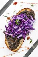 Portuguese stewed beef and red cabbage toasted open sandwich tapas snack photo