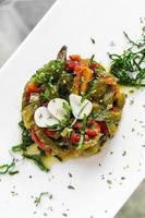 Portuguese roast organic bell peppers and garlic Mediterranean tapas salad in Lisbon restaurant photo