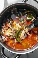 Traditional spicy tomato vegetable and egg soup stew in madeira Portugal photo