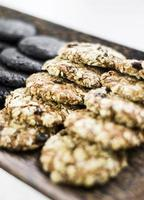 Mixed fresh organic oat biscuit cookies in bakery display photo