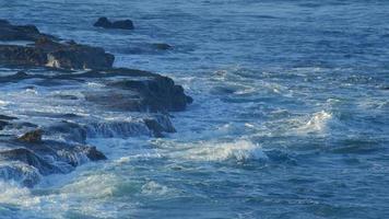 Sea wave crush rocks on a sea shore. video