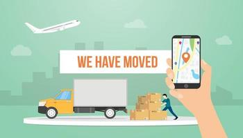 we have moved text banner title with hand holding smartphone and truck vector