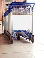 Supermarket trolleys in car park photo