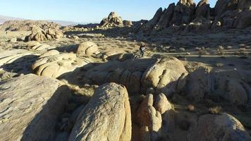 Man backpacking with his dog in a mountainous desert. video