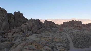 Aerial shot of a young man backpacking with his dog i video