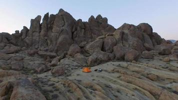 Aerial shot of a young man backpacker camping with his dog video