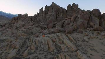 Backpacker camping with his dog in a mountainous desert. video