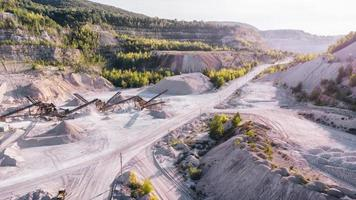 Aerial view of the limestone opencast quarry with conveyor system. photo