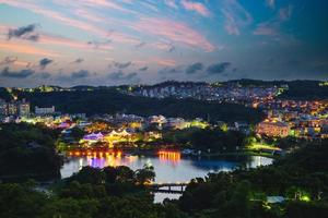 Aerial view of green grass lake in hsinchu, taiwan at night photo