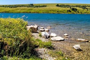 Along the shore line at Chain Lake Provincial Park in Alberta, Canada photo