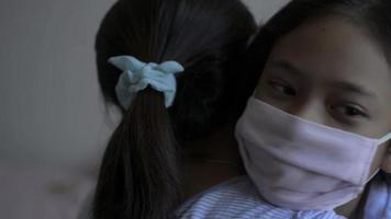 Mom and daughter wears face mask hugging each other during COVIC 19. video