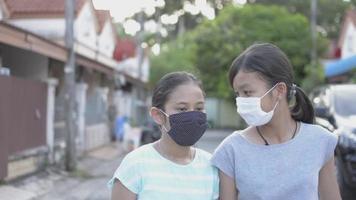Two girls wear face mask enjoy to practice dance during walking. video