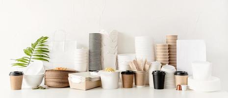Eco friendly disposable tableware and eating utensils on table photo