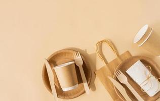 Disposable bag and tableware cup, plate, and wooden fork, knife photo