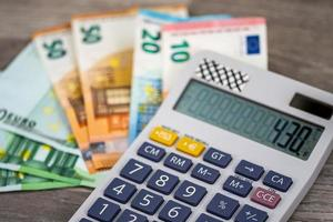 50 100 euro banknotes with calculator photo