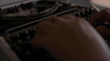 Close up hands of woman typing on retro typewriter during working. video