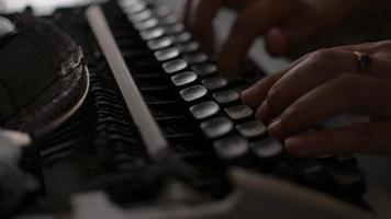 Hands of female office worker typing on retro typewriter on the desk. video