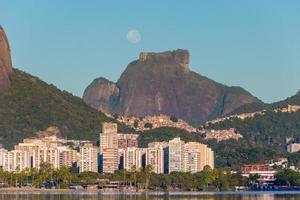 Moon setting near Gavea Stone in Rio de Janeiro, Brazil photo