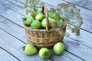 Basket with vegetables and dill sprigs photo