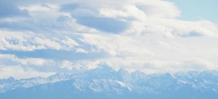 Range of mountains and clouds photo