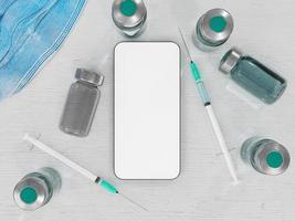 teléfono móvil con vacunas y jeringas foto