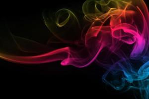 Abstract colorful smoke on black background photo