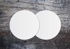 White circle paper and space for text on wooden crack background photo