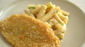 Quadrotto penne pasta white cream sauce with fried fish fillet video