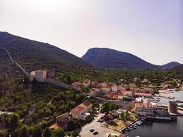 Mali Ston waterfront aerial view, Stone walls in Dalmatia Croatia photo