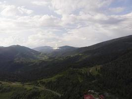 Foggy summer morning in the Carpathian mountains photo