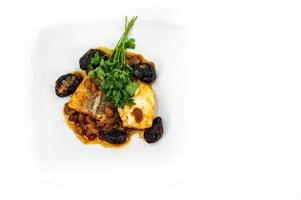 plate of sweet and sour cod on white plate photo