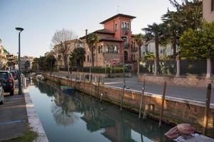 Lido di Venezia, Italy 2019- Buildings near the Canal in Lido di Venezia photo