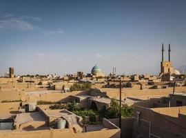 Downtown rooftops wind towers and landscape view of Yazd city old town in Iran photo