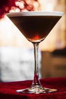 Coffee espresso cream martini cocktail drink glass inside cozy bar photo