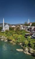 Neretva river and mosque in old town of Mostar Bosnia photo