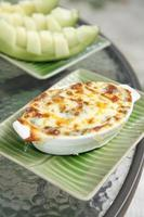 Baked spinach with cheese in ceramic cup on table photo