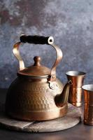 Ancient Moroccan tea pot on a wooden tray photo