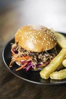 Pulled pork and coleslaw salad burger sandwich with french fries snack meal photo