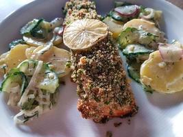 Salmon steak with potato salad photo